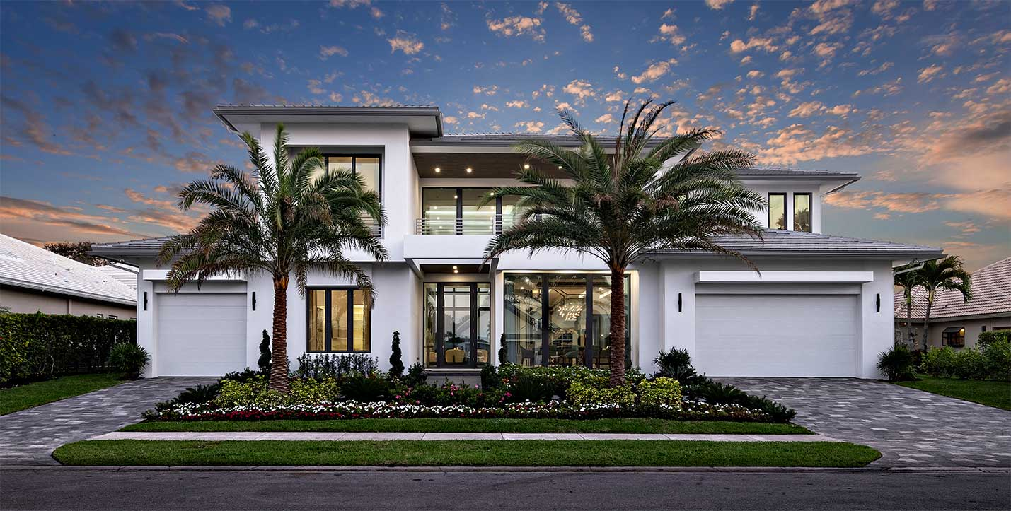 Front view of Tallowwood Isle home with hurricane resistant garage doors