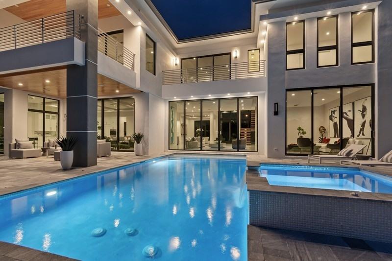 rear exterior of Deerfield Beach home with custom impact glass windows and doors