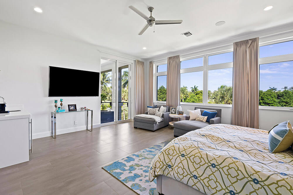 impact picture windows and sliding glass door in a South Florida bedroom