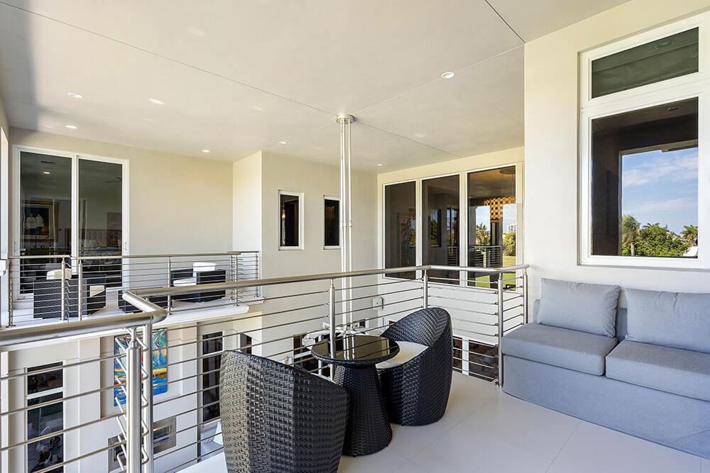 comfortable South Florida home balcony with hurricane windows