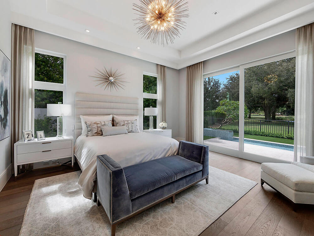 custom glass windows and doors in a South Florida bedroom