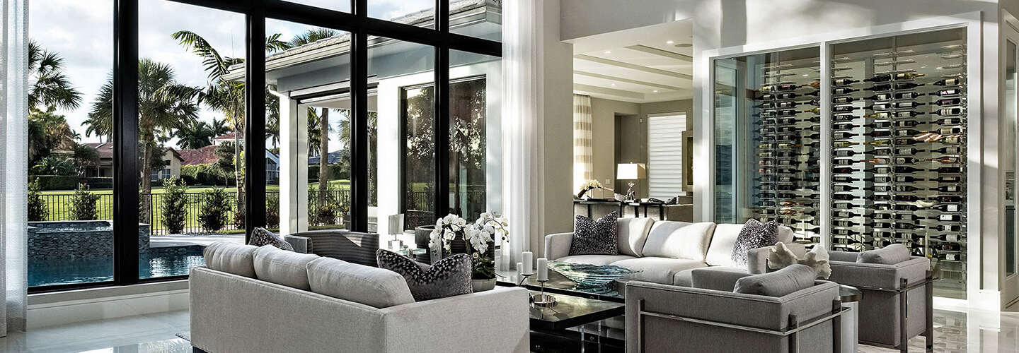 living room with custom wine closet and impact floor to ceiling windows