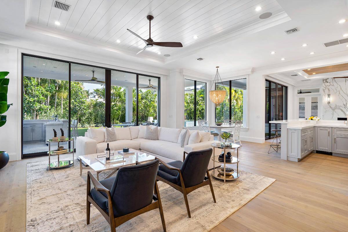 hurricane impact windows and doors in an open floor plan living space