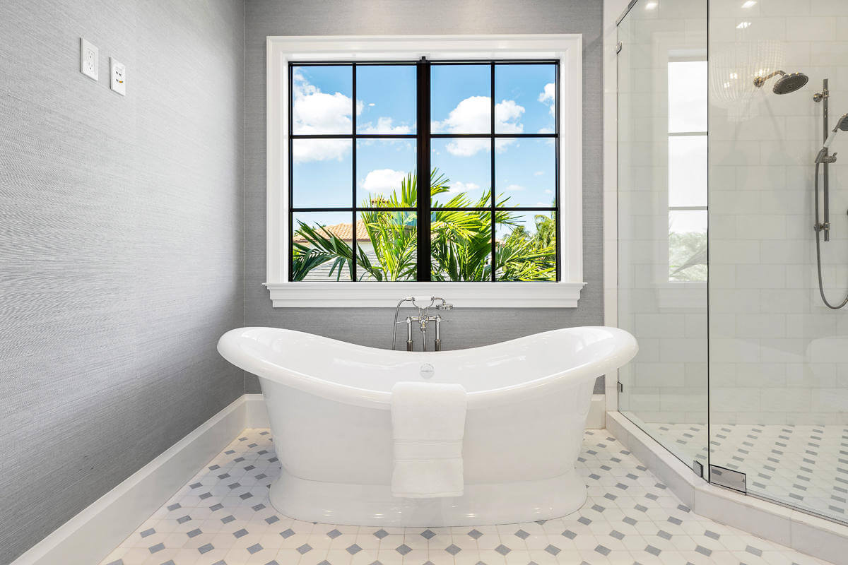 custom shower and impact windows in a South Florida bathroom with soaking tub