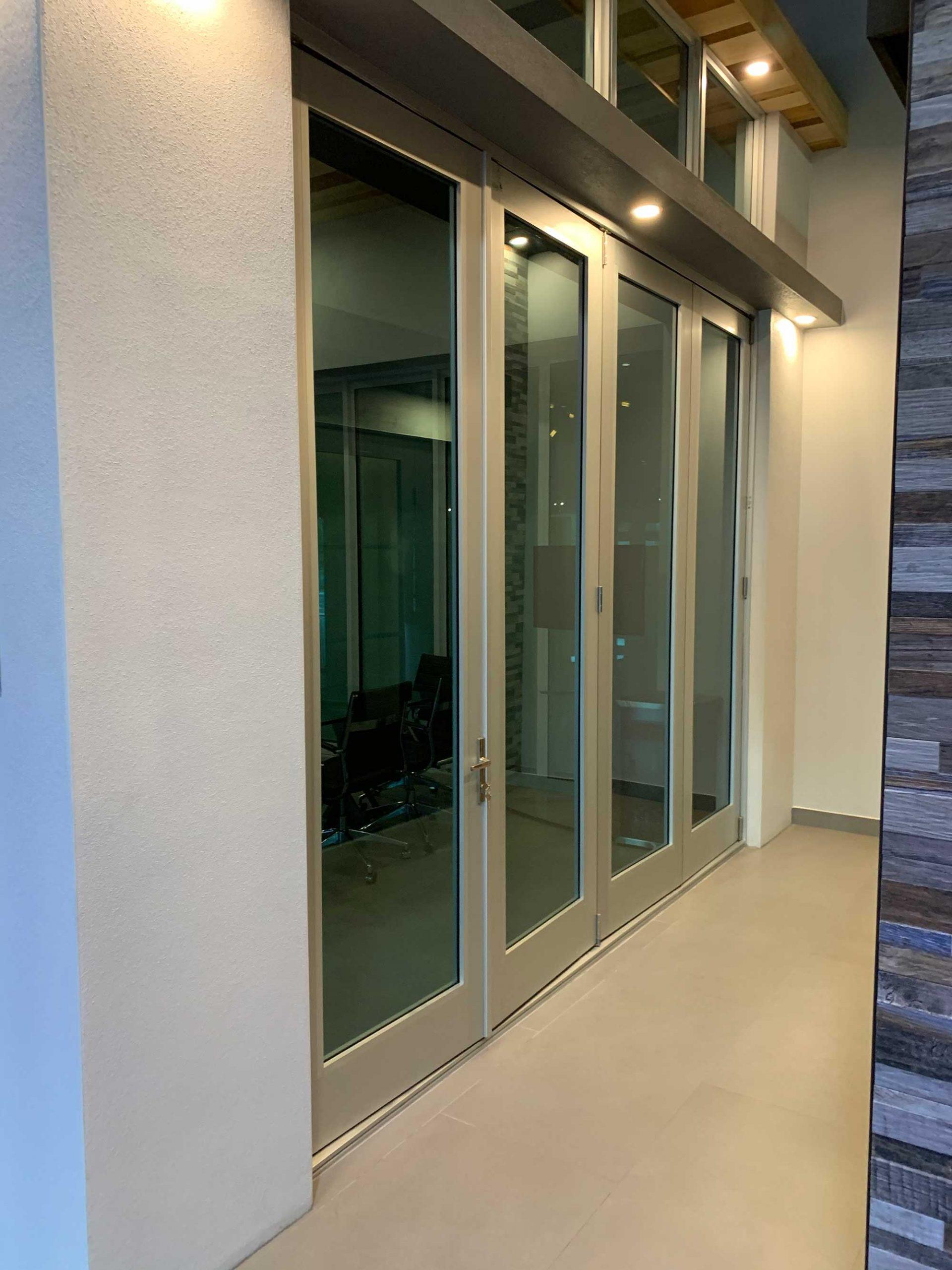Bi-fold custom glass door and windows