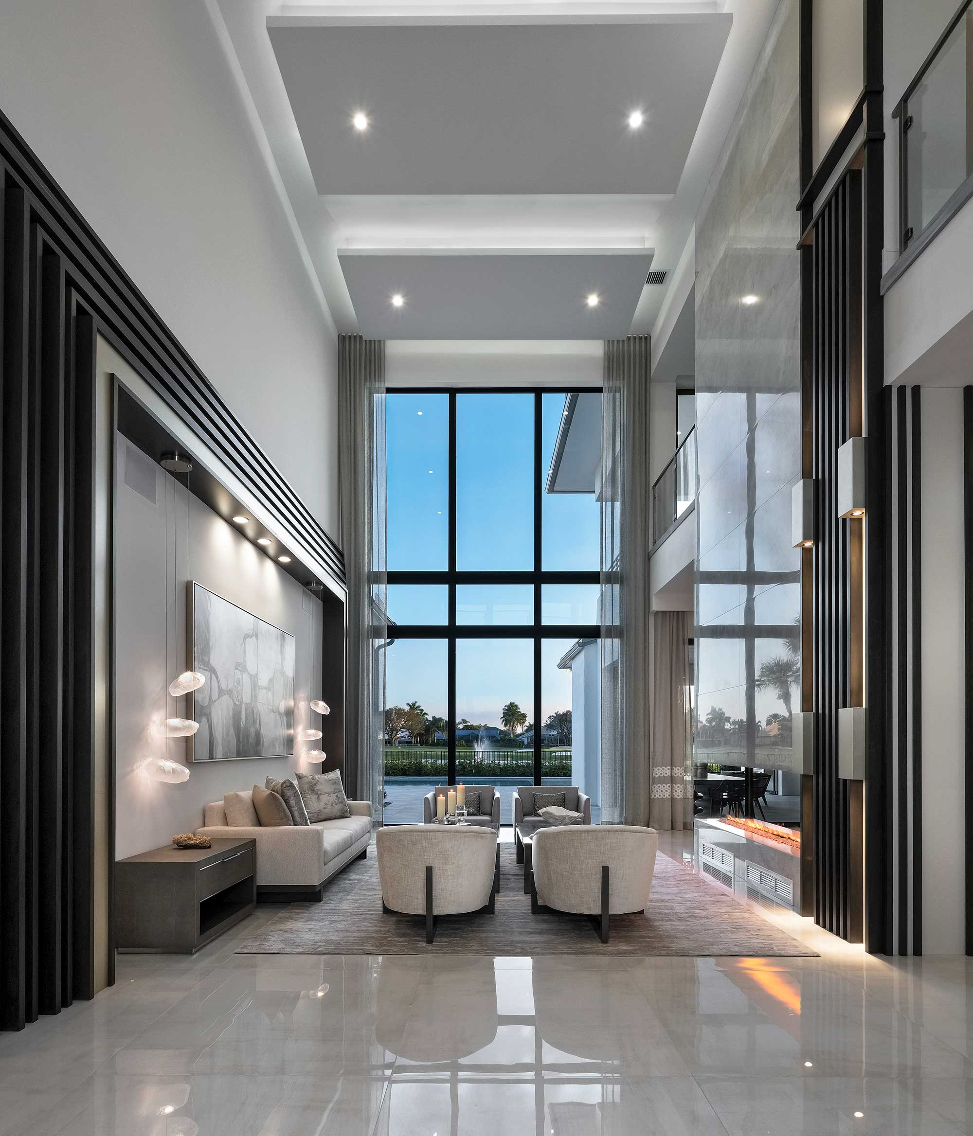 Coconut Creek home lounge area with tall impact windows